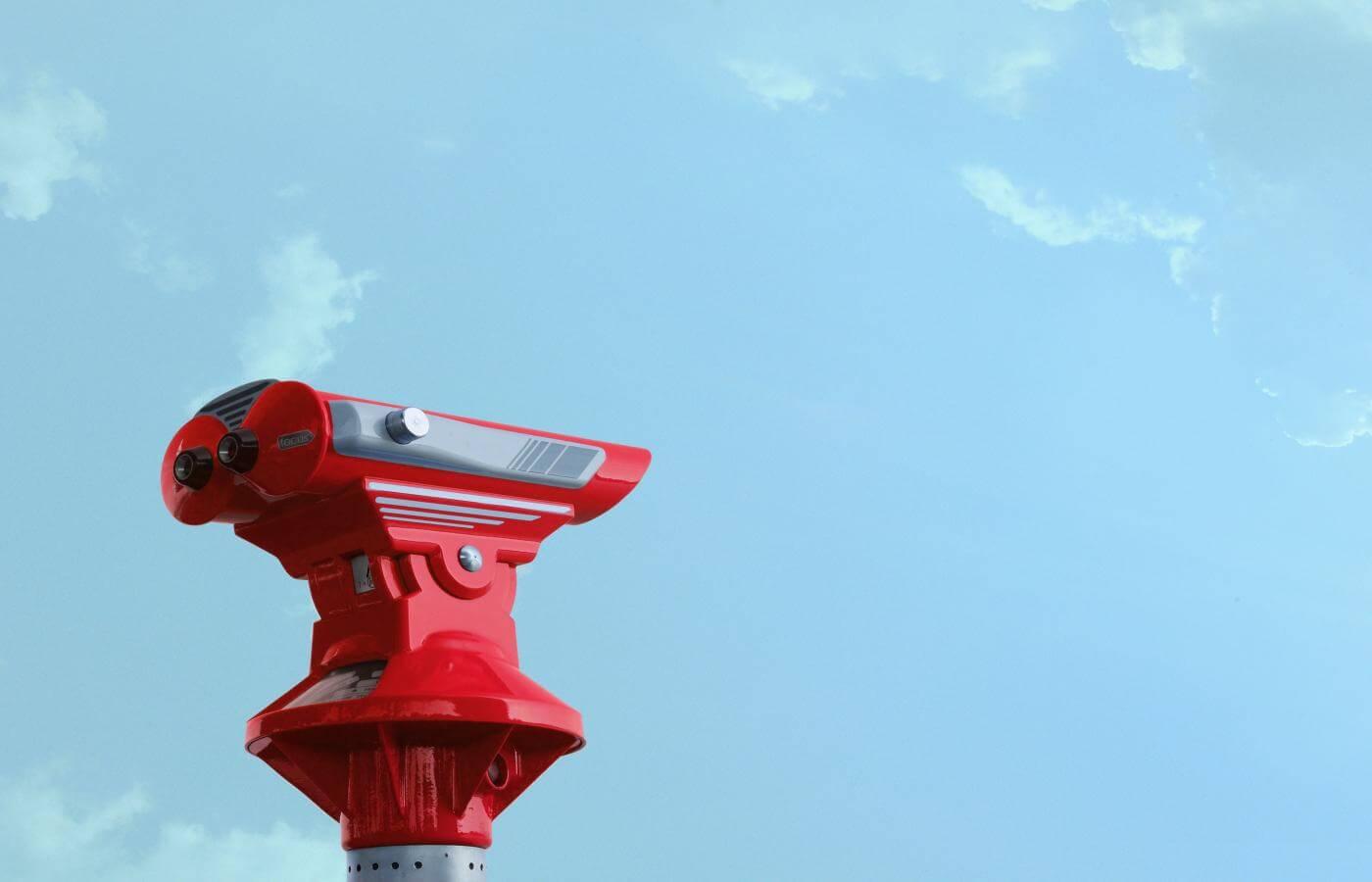 SEO Search Intent Brisbane - Red Binoculars and blue sky