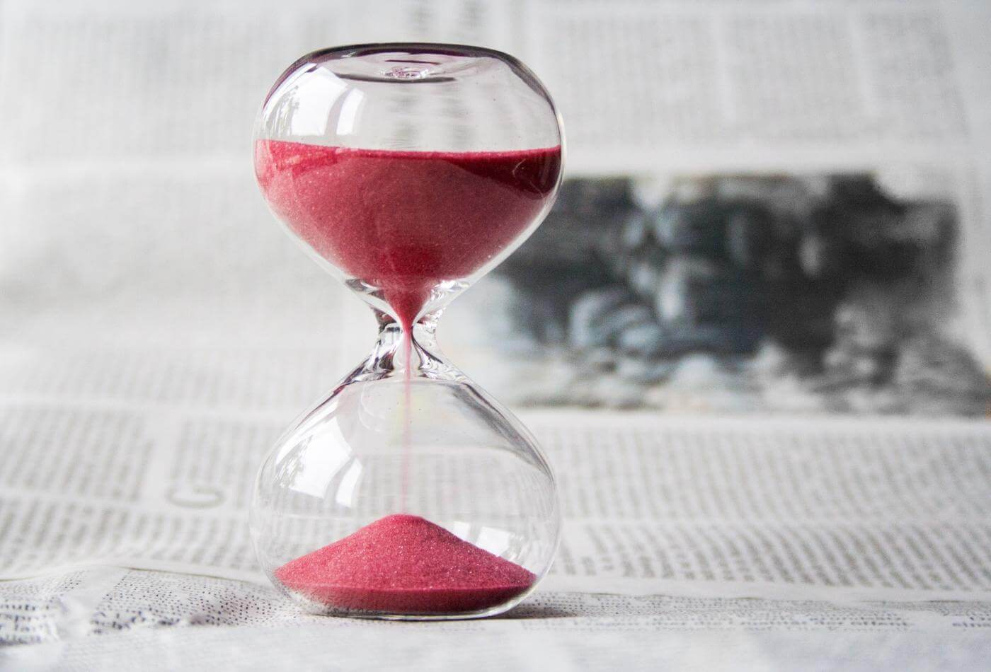 Why SEO Takes Time - Hour Glass Red Sand Image